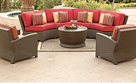 A light pink colored Bali sectional club chairs and Ottoman by Paradise Home & Patio