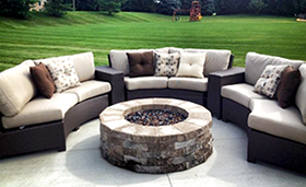 A cream and brown color mixture, Bali sectional with fire pit by Paradise Home & Patio