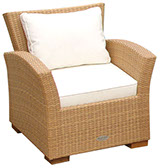 A honey-colored royal teak wicker deep seating Charleston chair by Paradise Home & Patio