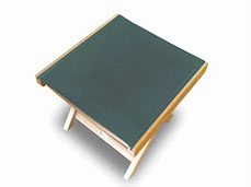 A moss-green colored royal teak footrest by Paradise Home & Patio