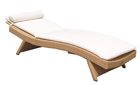 A honey-colored royal teak wicker wave sunbed by Paradise Home & Patio