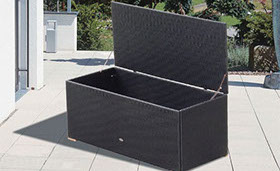 A black colored wicker storage box by Paradise Home & Patio