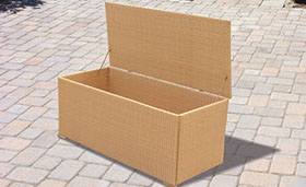 A honey-colored wicker storage box by Paradise Home & Patio