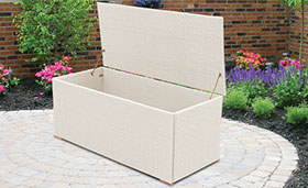 A white-colored wicker storage box by Paradise Home & Patio